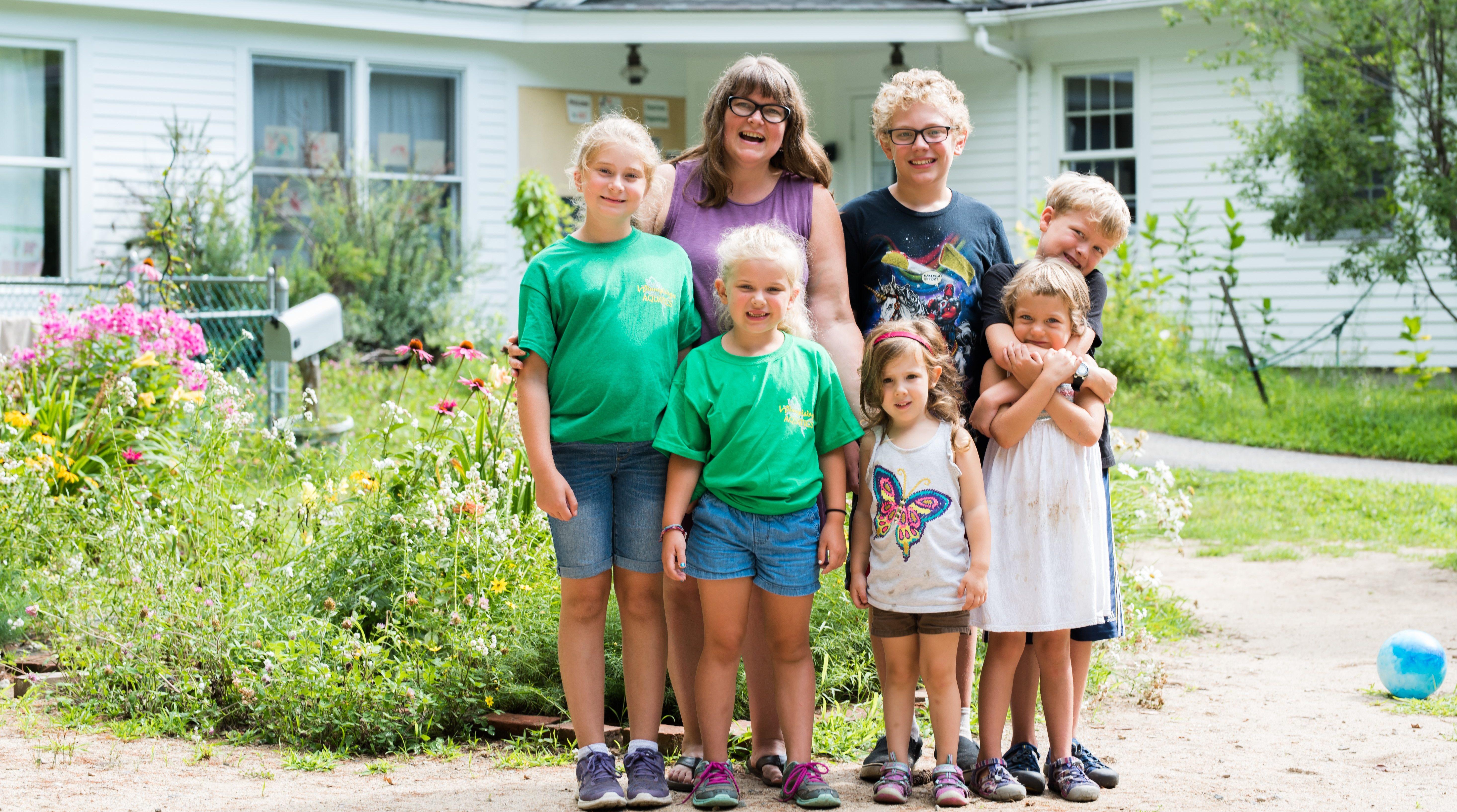 Photo of preschool teacher and children