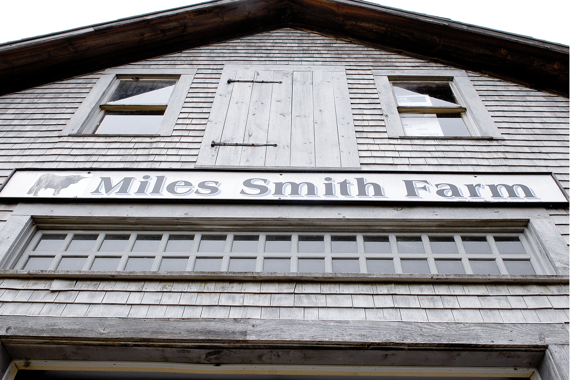 Barn with large sign that says Miles Smith Farm