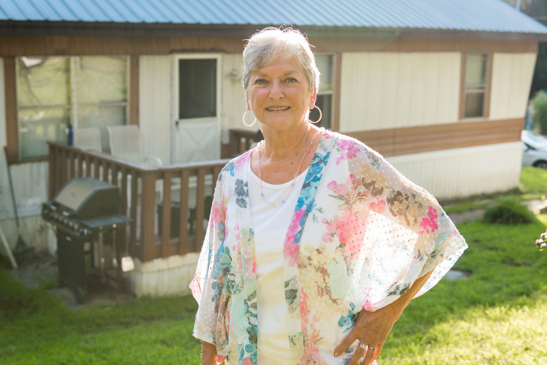 Woman in front of manufactured home