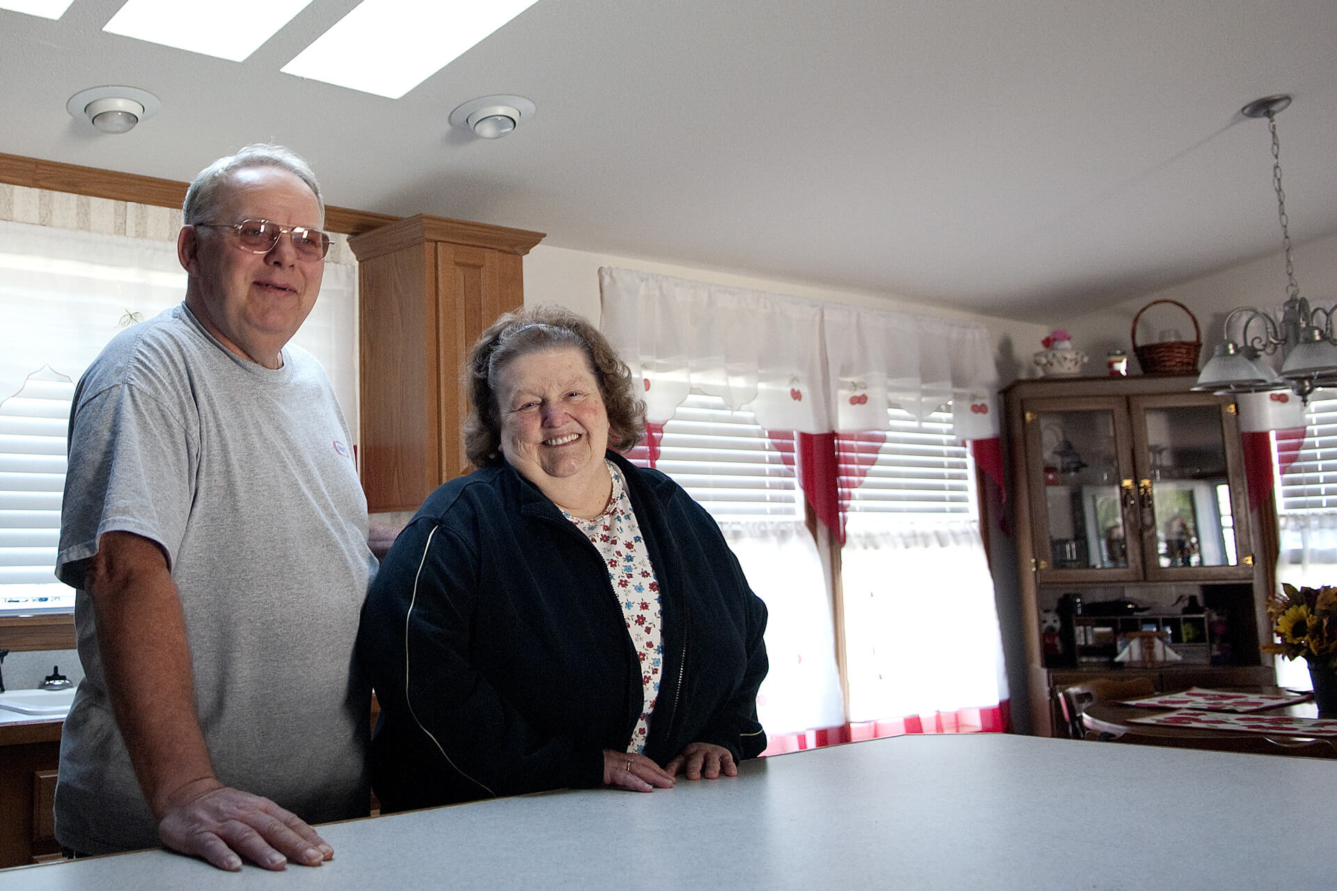 Man and woman stand at their kitchen counter