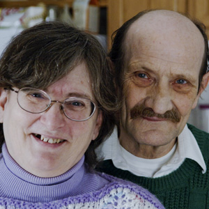 Man and woman smiling at camera