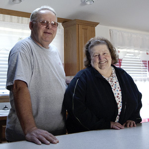 Man and woman standing in their kitchen