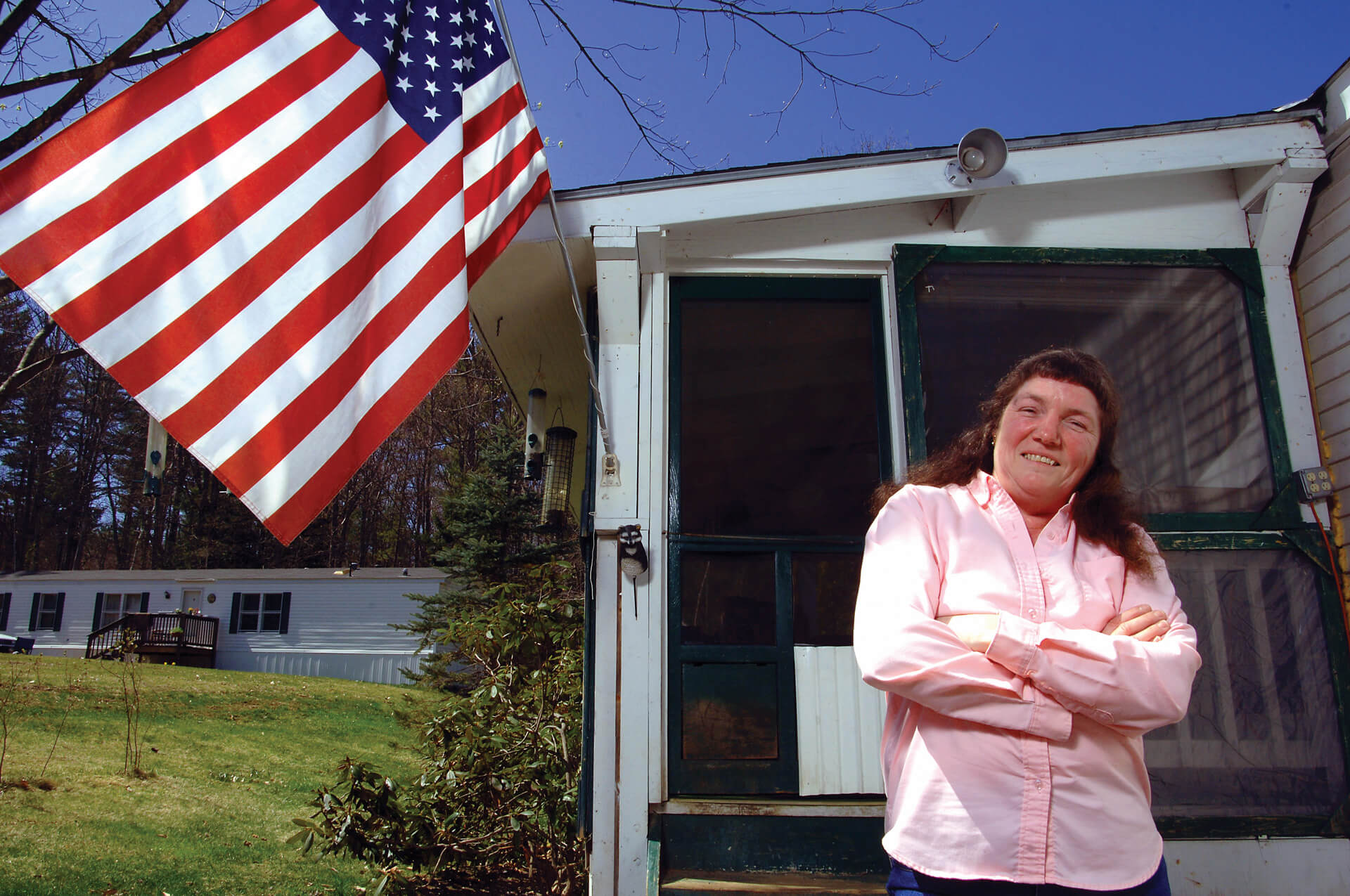 Woman stands proudly outside manufactured home