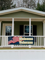 Porch of manufactured home with a sign that says Welcome Veterans