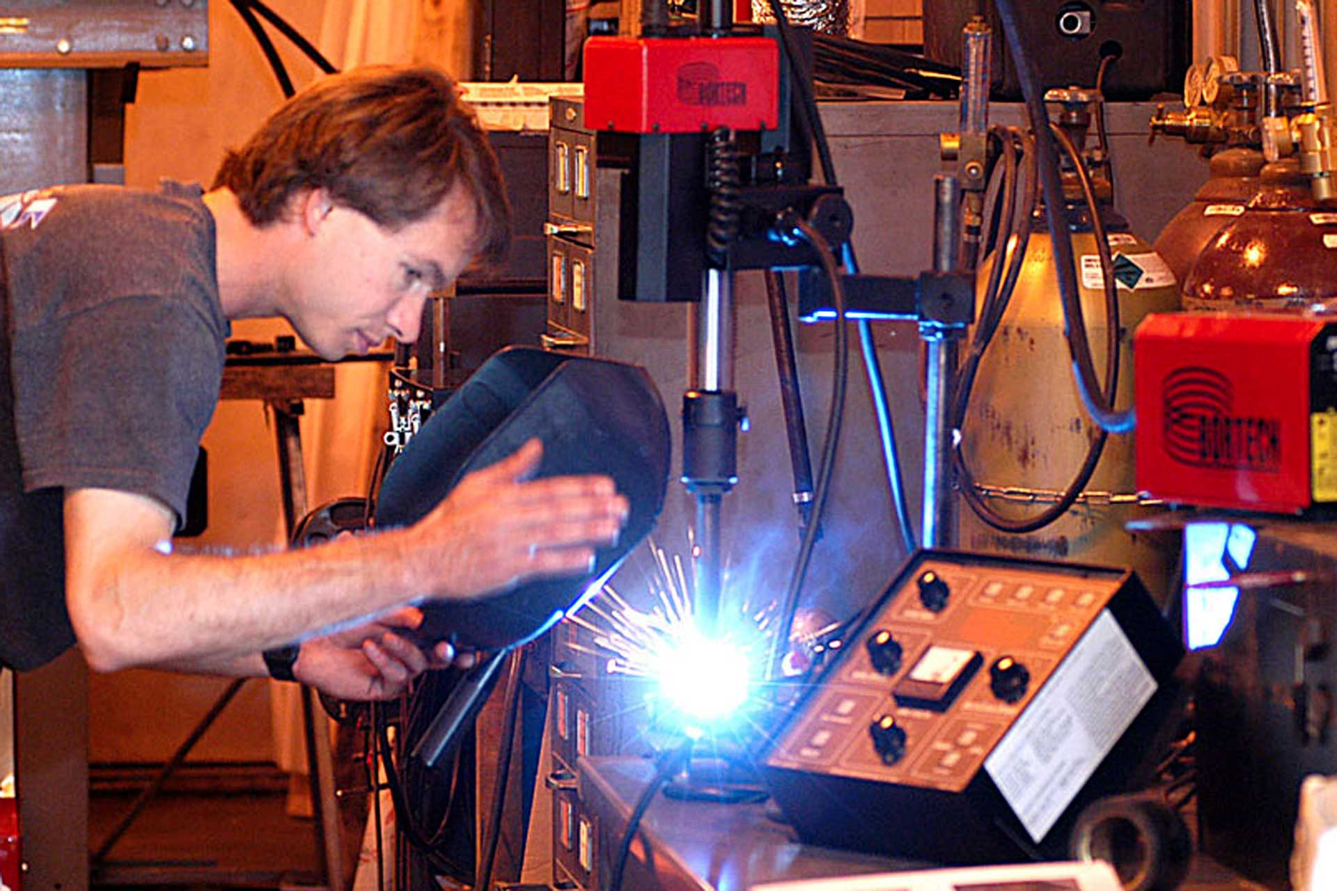 Sparks fly as a machinist's station.