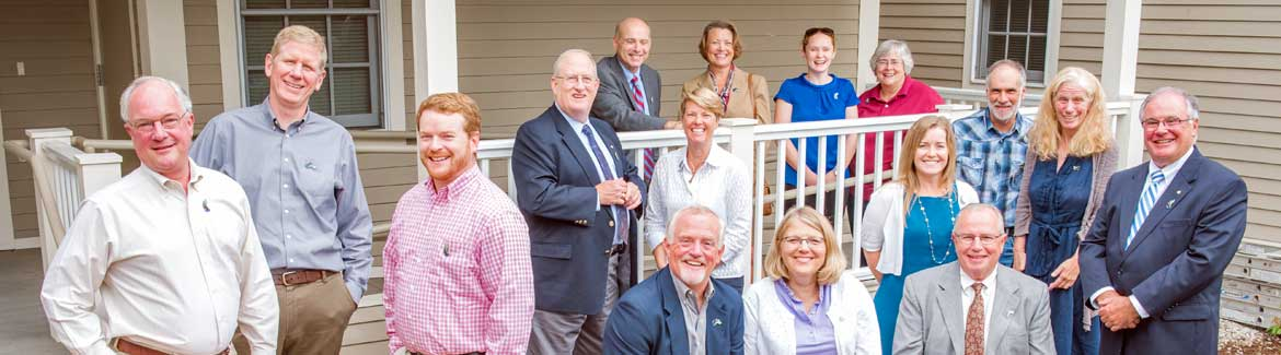 A group of investors gathered on the porch of the Community Loan Fund