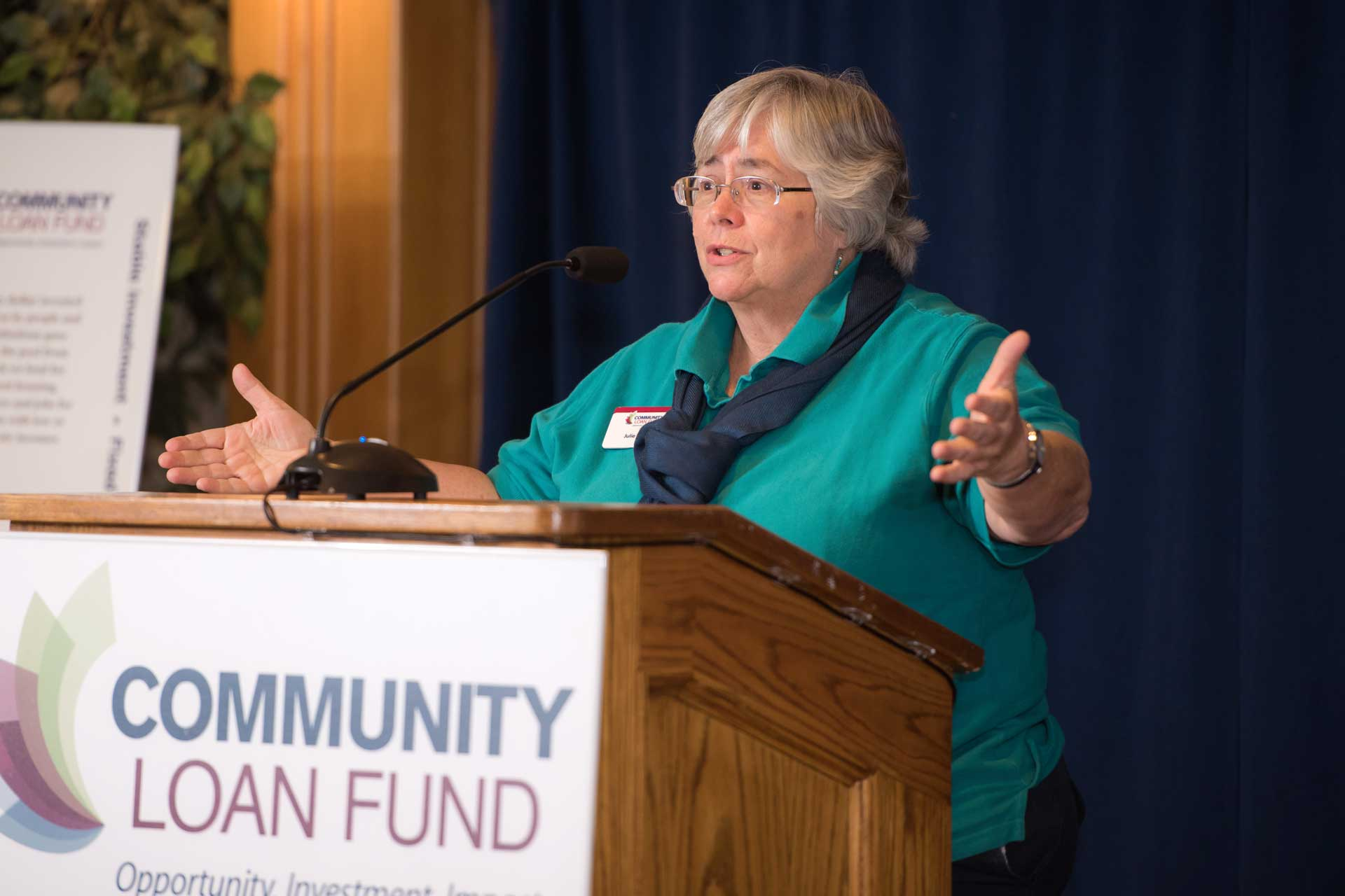Community Loan Fund President Juliana eades speaks at podium