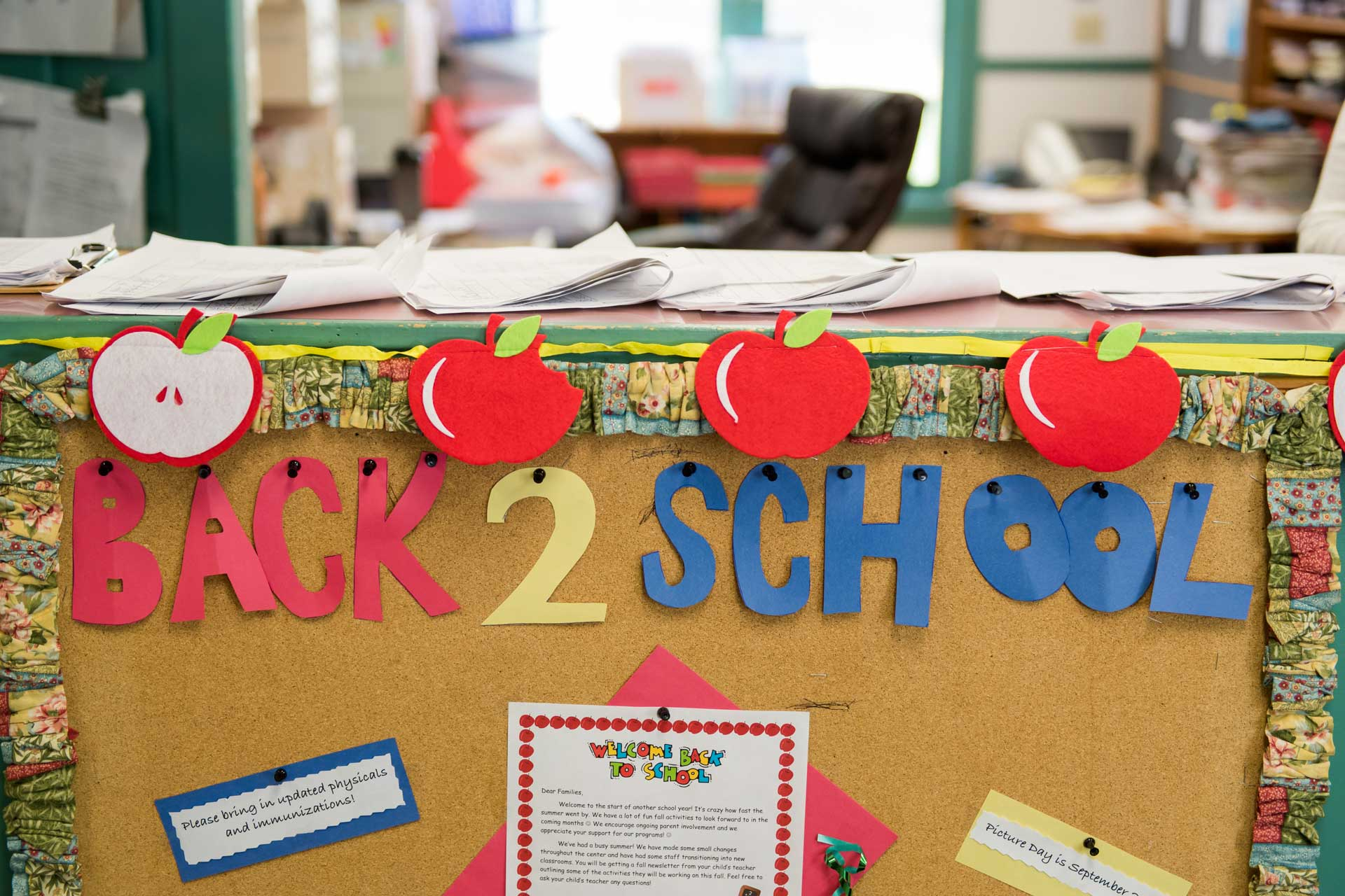 counter with back 2 school sign and cut out apples
