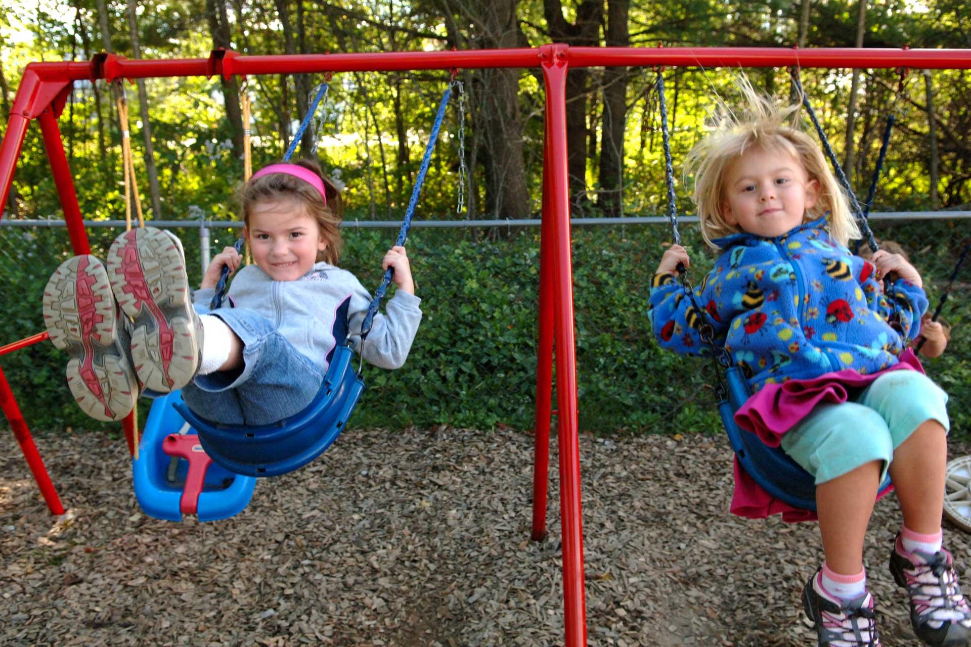 2 girls on swings