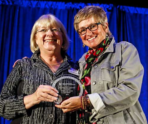 Julie McConnell receives the first SHE Change award