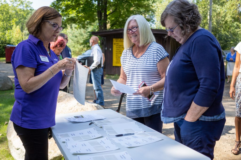 Three woman at event registration table