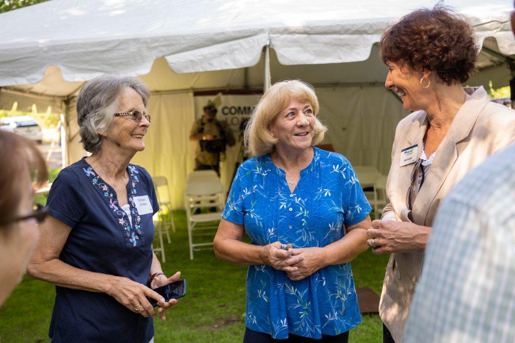 Three woman chatting