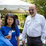 NH Community Loan Fund President Juliana Eades talks with three people.