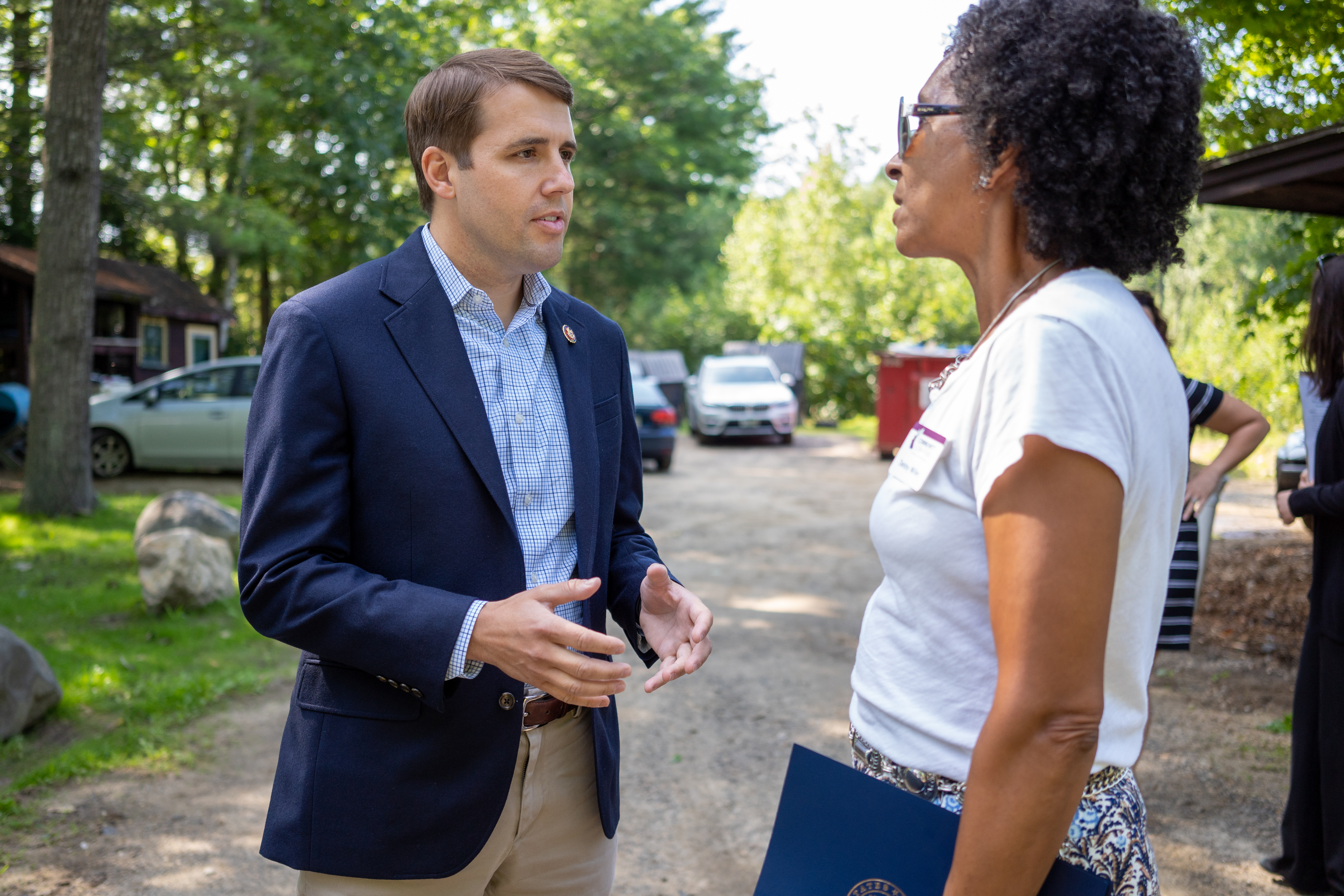 NH Congressman Chris Pappas talks with the Community Loan Fund's Debby Miller
