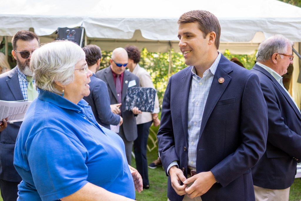 NH Community Loan Fund President Juliana Eades talks with Congressman Chris Pappas.