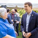 NH Community Loan Fund President Juliana Eades talks with Congressman Chris Pappas.
