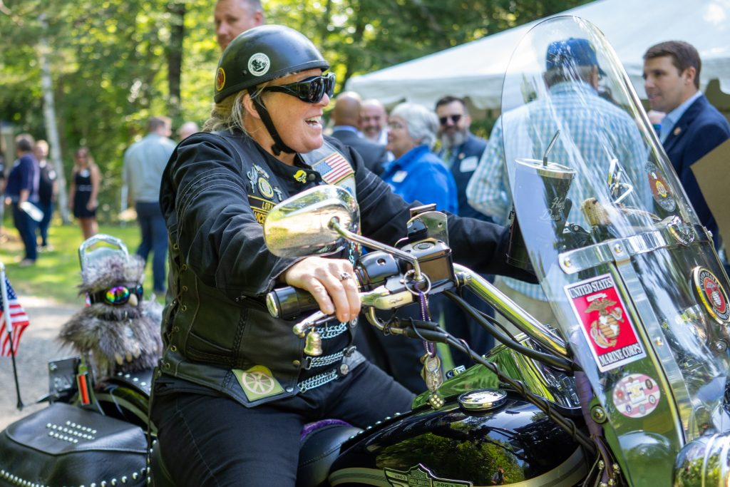 Lora Gervais arrives on a motorcycle.