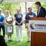 Congressman Chris Pappas congratulates the Rock Rimmon Cooperative's four board members