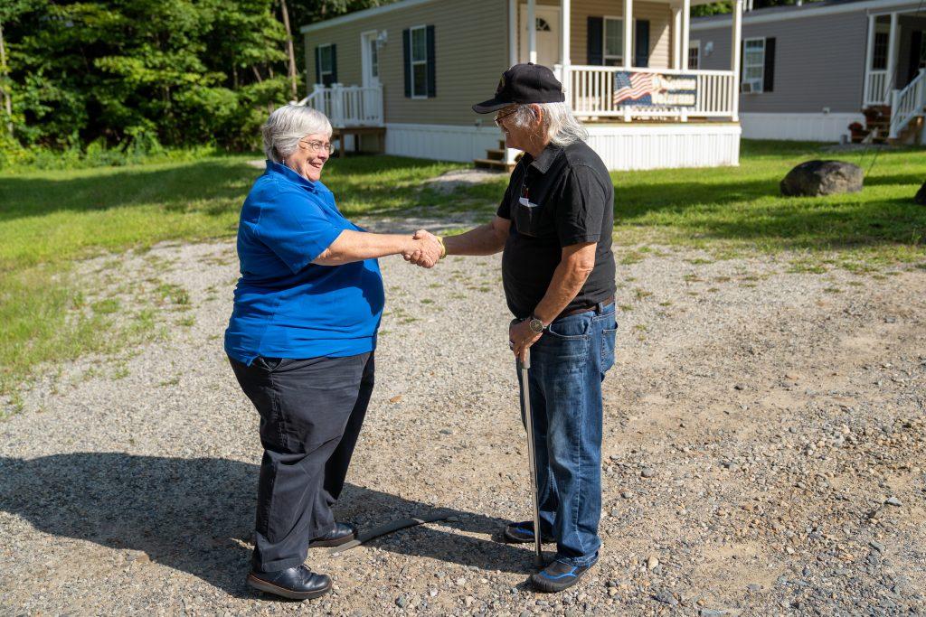 President Juliana Eades meets Peter Searching Owl Giove, a U.S. military veteran