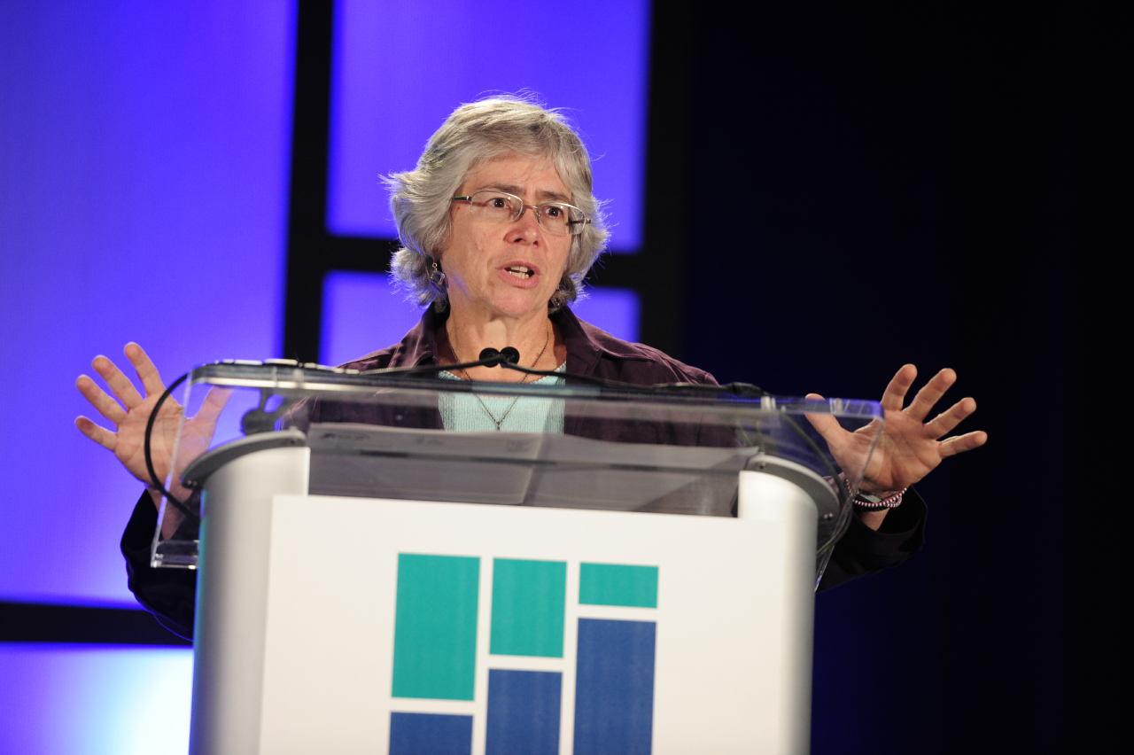 woman speaking behind podium