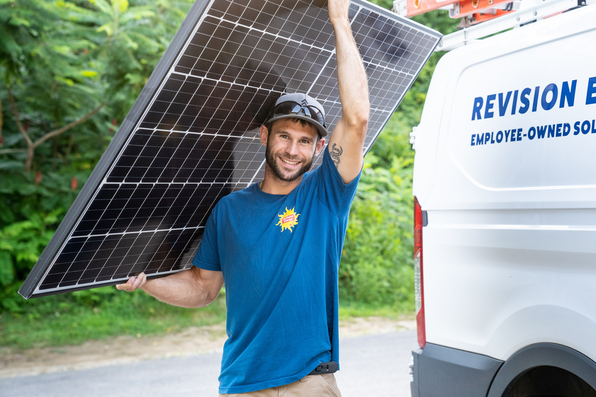 Worker carrying a solar panel