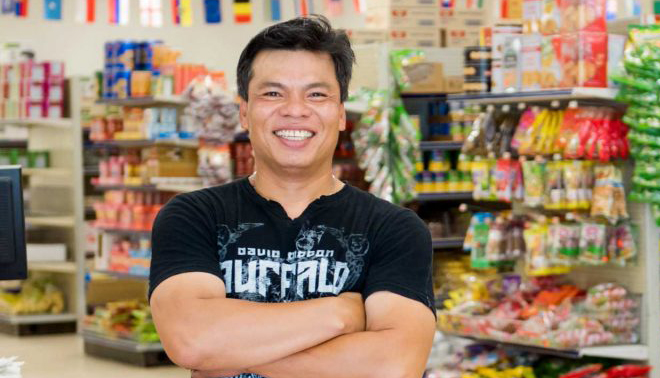 man smiling in store