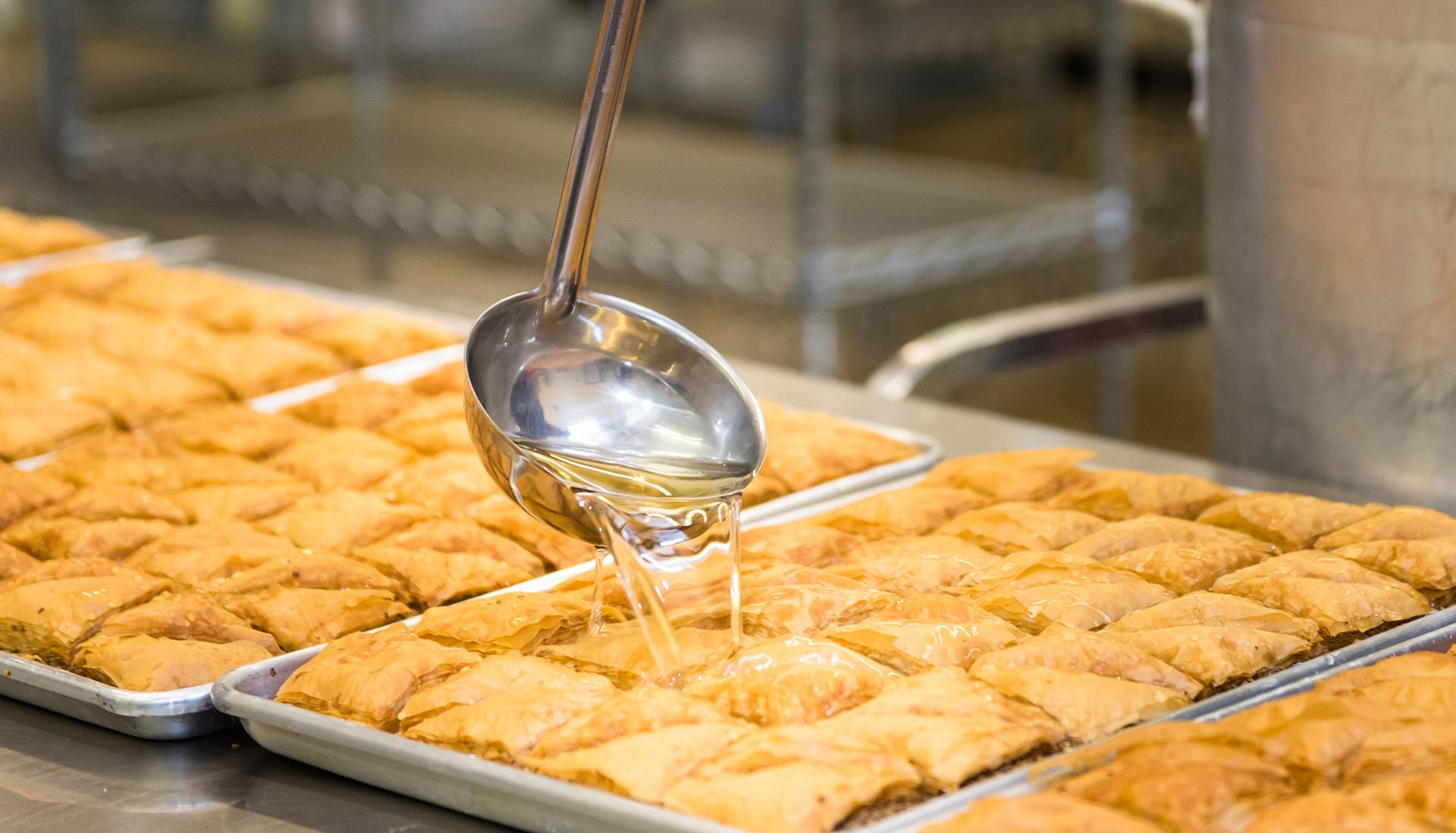 honey poured over baklava