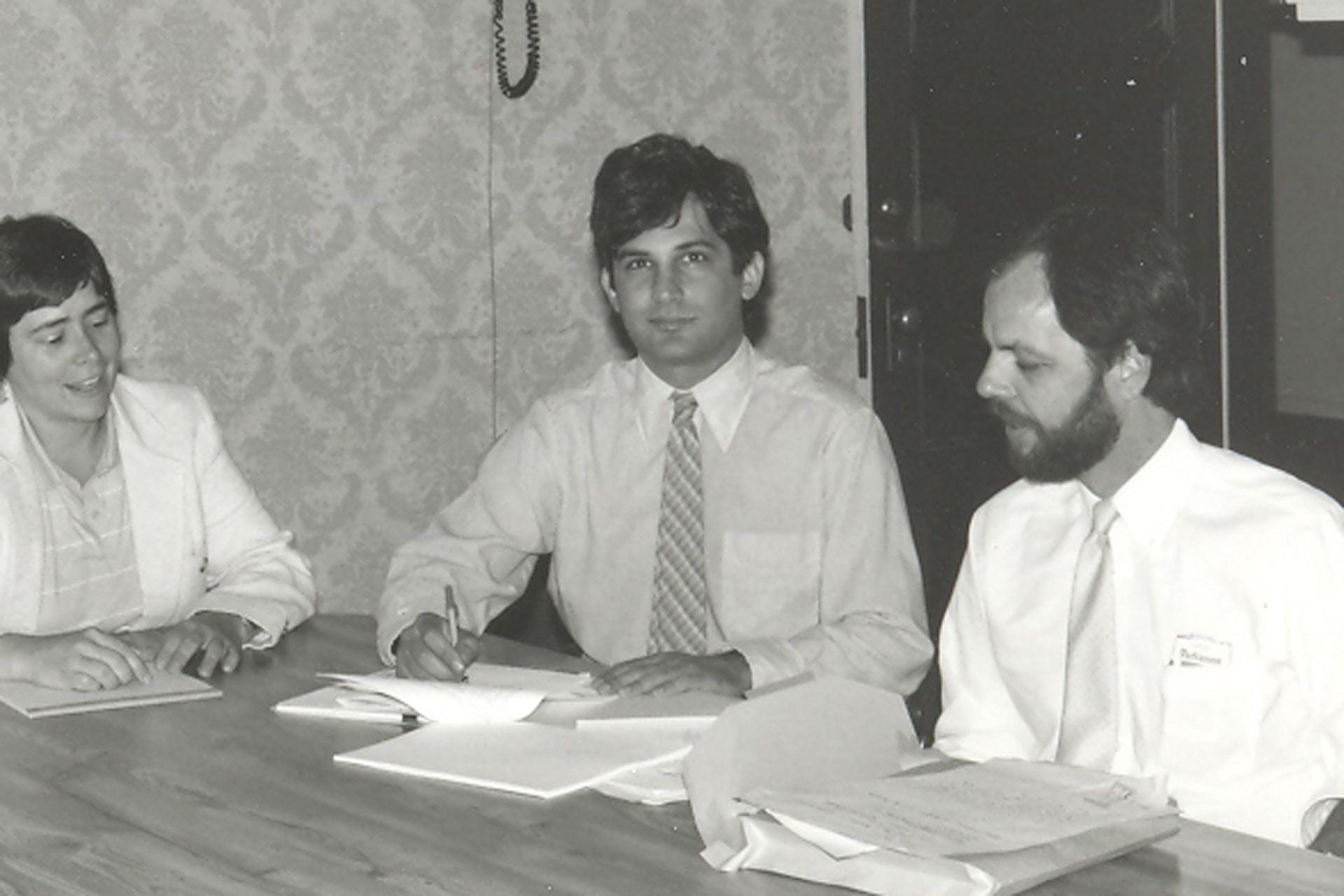 Three people making plans at a table