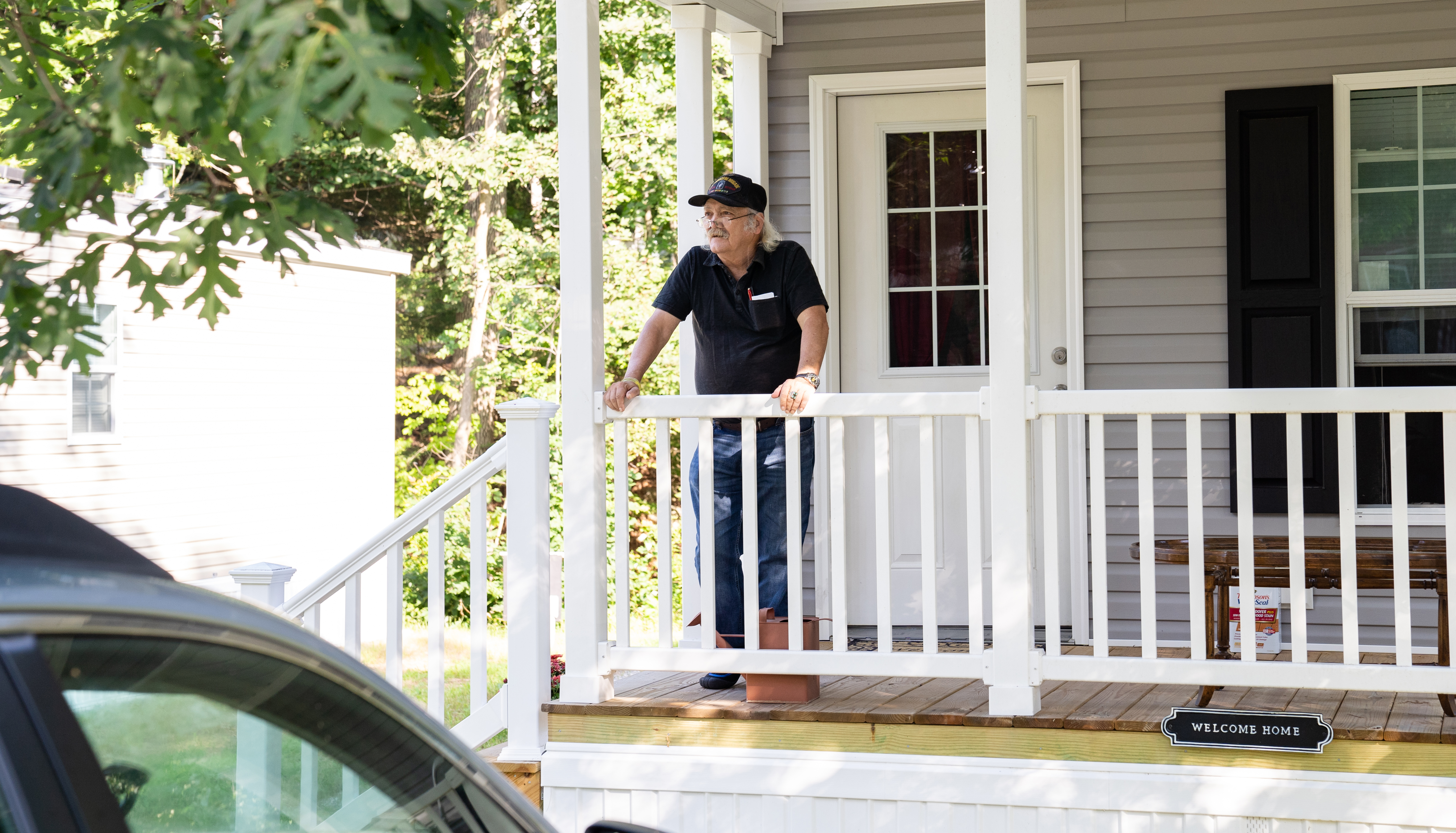 veteran stands on porch