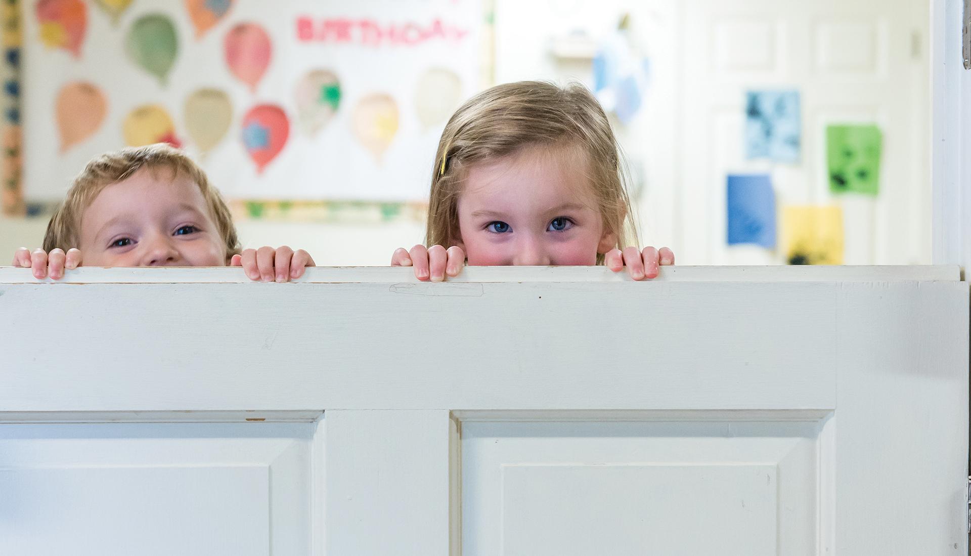 kids peeking over door