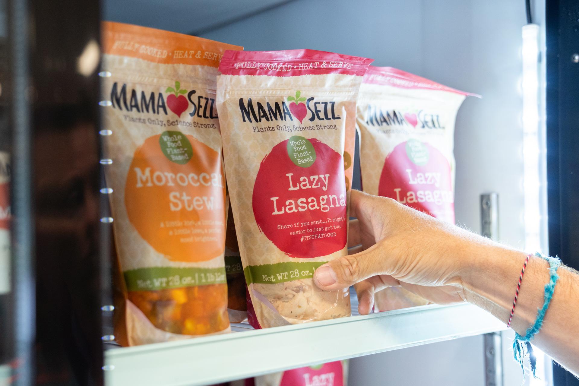 Bags of MamaSezz food on refrigerator shelf