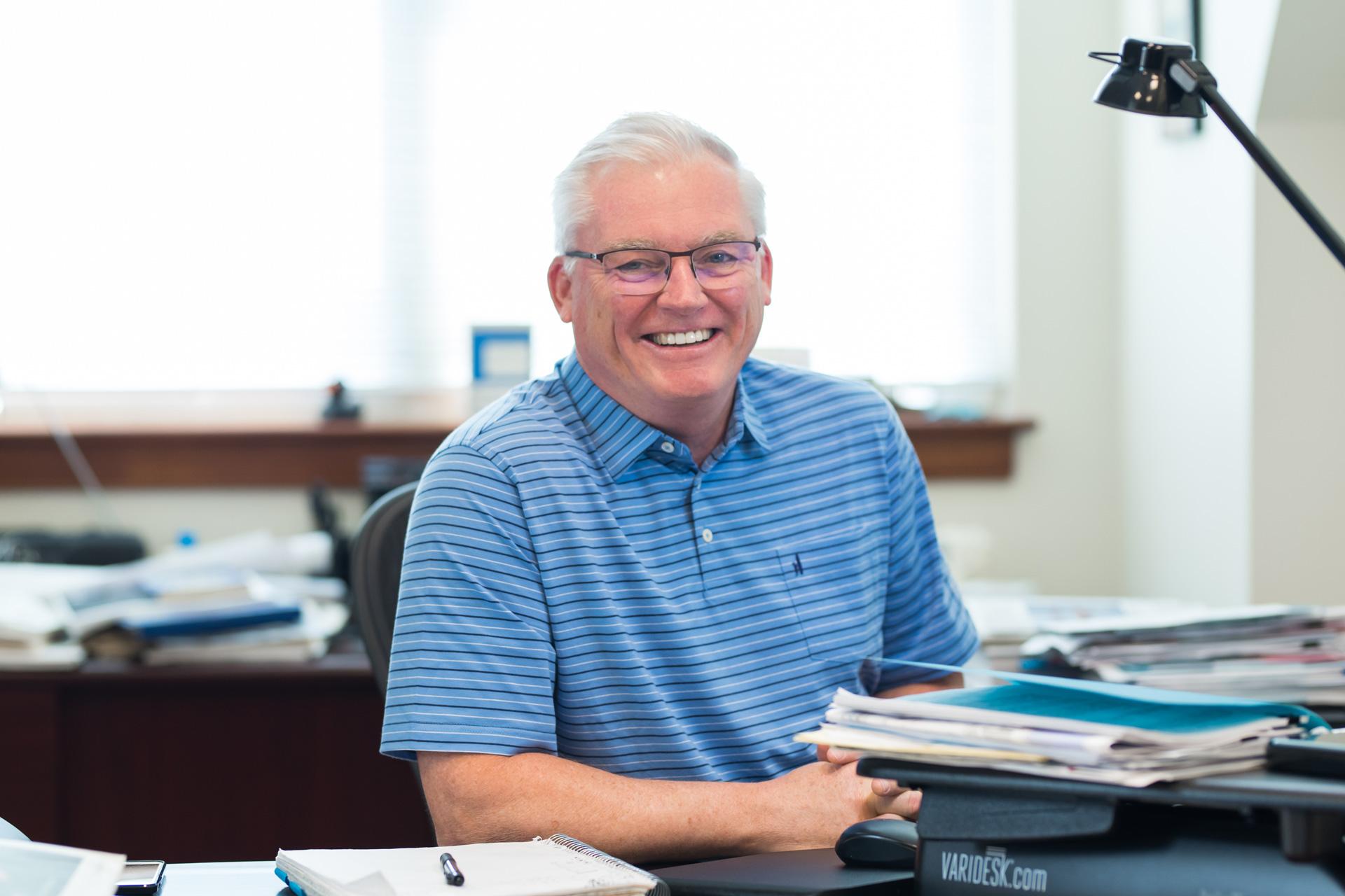 Man smiling at desk