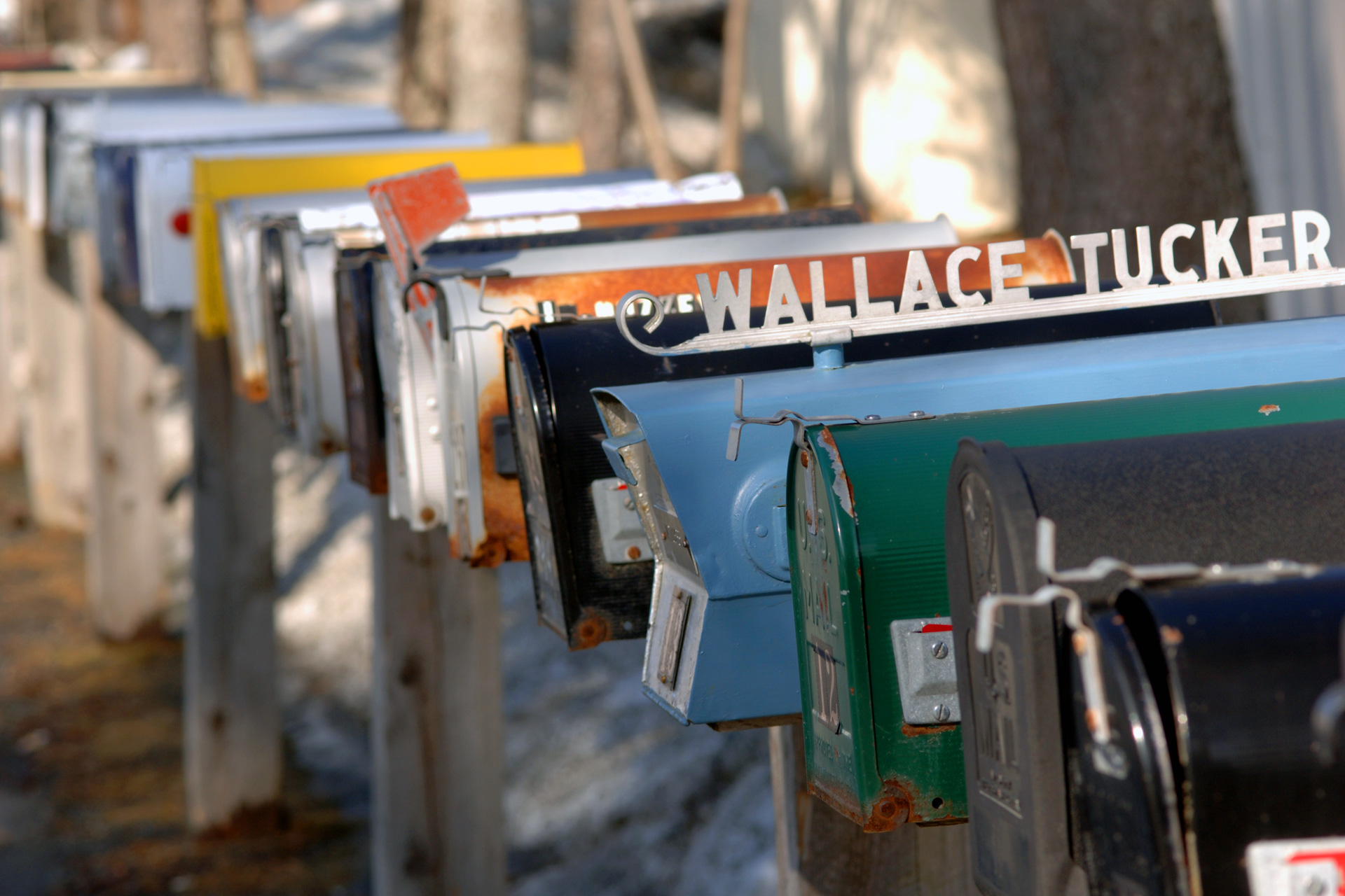 A row of mailboxes in front of a resident-owned manufactured-home community