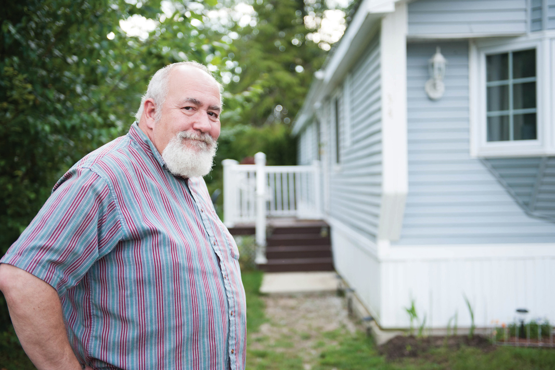 Man standing outside manufactured home