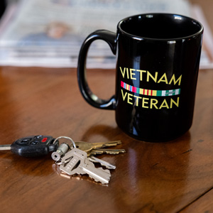 """A veterans coffee cup and house keys say """"welcome home."""""""
