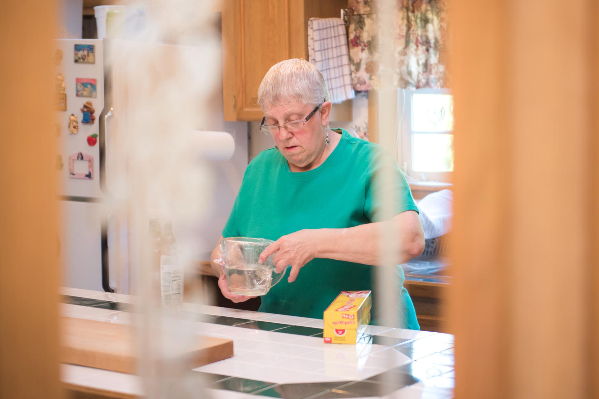 Woman at kitchen counter