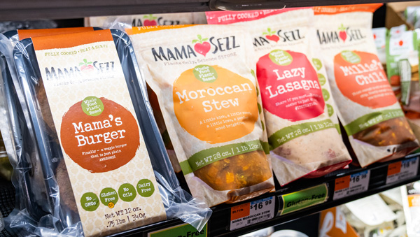 Bags of MamaSezz meals on the shelf of a local cooperative market.
