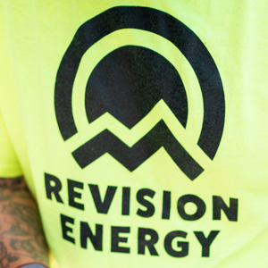 ReVision Energy's logo on a tee shirt.