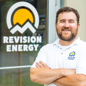ReViosion Energy stands with arms crossed in front of logo