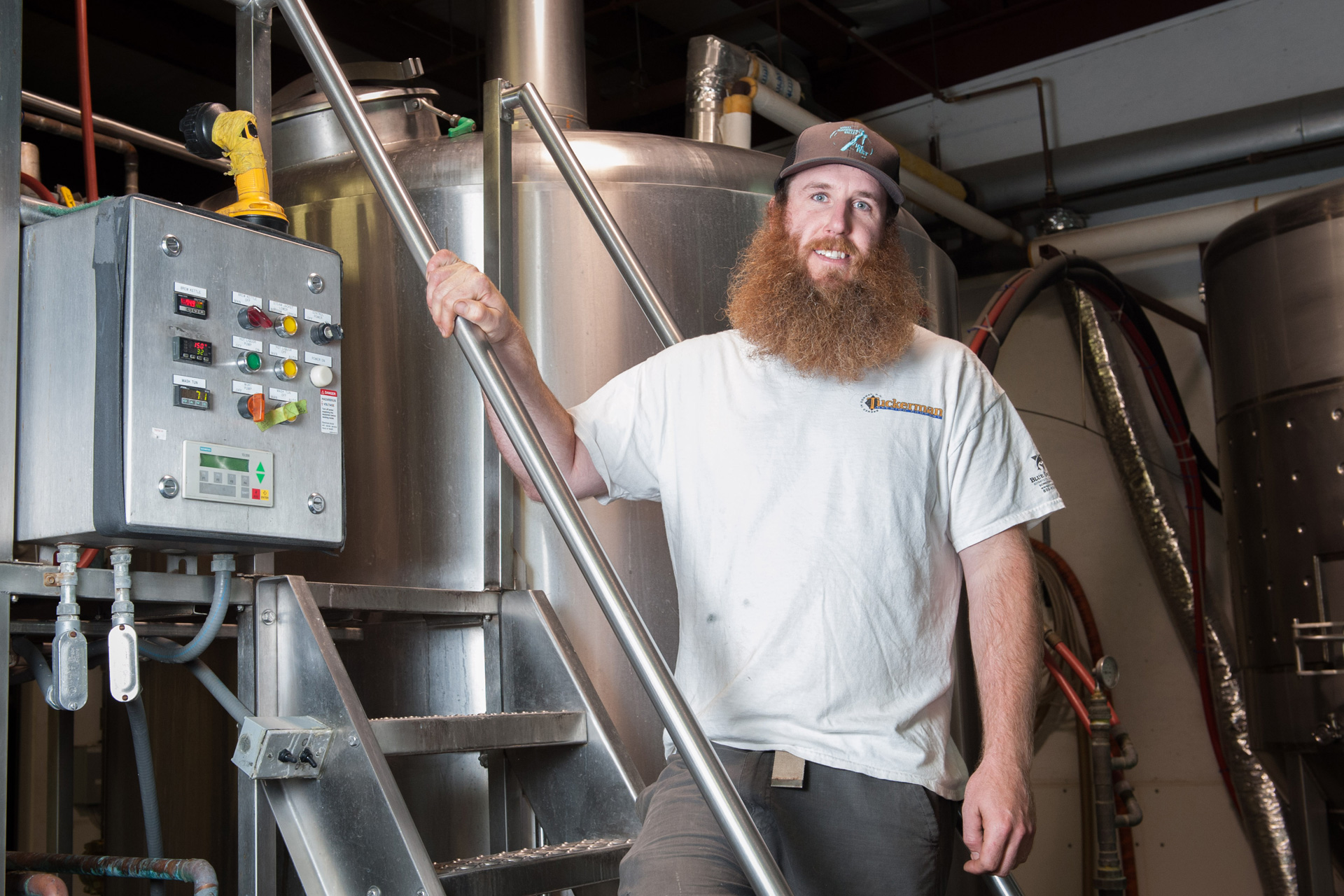 A bushy-bearded brewer at Tuckerman Brewing Co.