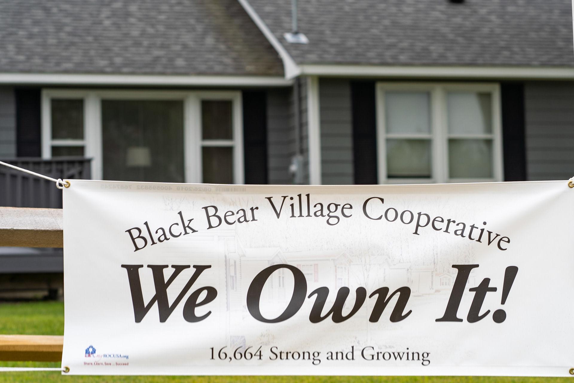 A sign saying We Own It hangs outside Black Bear Village Cooperative in Conway