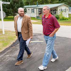 Two men walk through Black Bear Village Cooperative