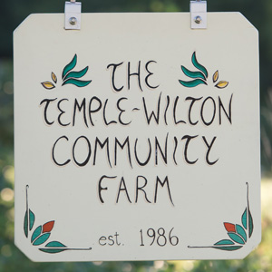 A colorful sign welcomes visitors to Temple-Wilton Community Farm