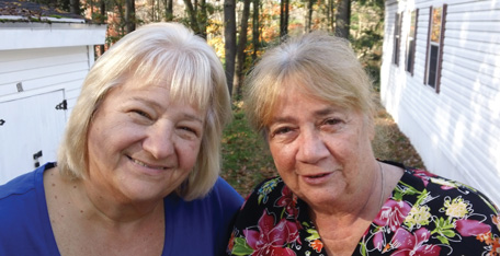 A pair of smiling women at Centennial Estates Cooperative in Derry.
