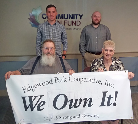 Edgewood Park board members and ROC-NH staff celebrate the co-op's purchase of its community.