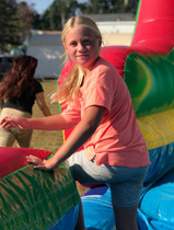 A girl at the bottom of an inflatable slide at the Greenvill celebration.