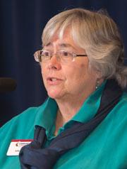 Julie Eades speaks from podium.