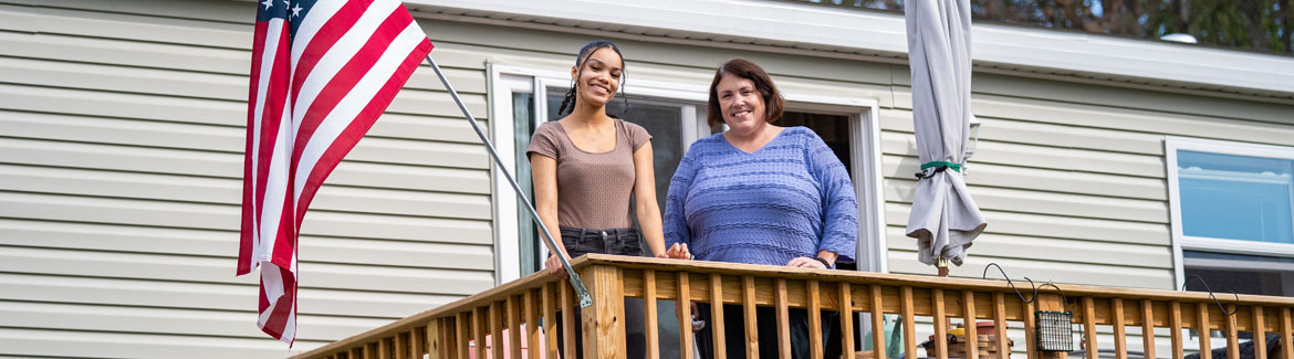 Jenn McLachlin and her daughter Ashley on the deck of their affordable manufactured home.